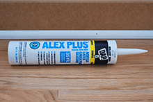 Use a good latex caulk that is paintable to fill voids between the beadboard and the baseboard.  Also use in the inside corners