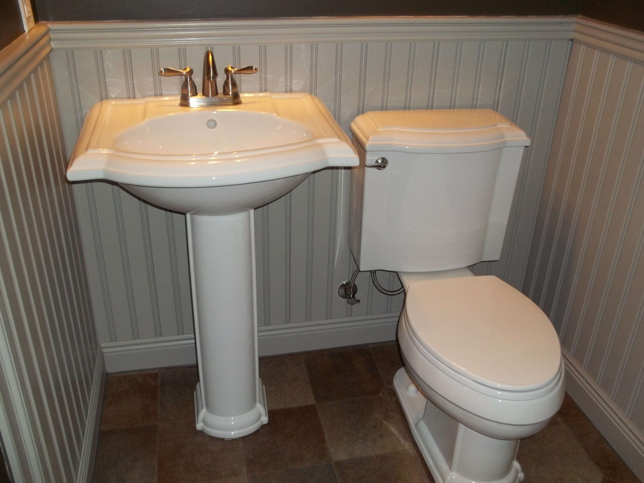 "American Beadboard panels with 3 1/4"" top cap / chair rail molding and kohler fixtures"