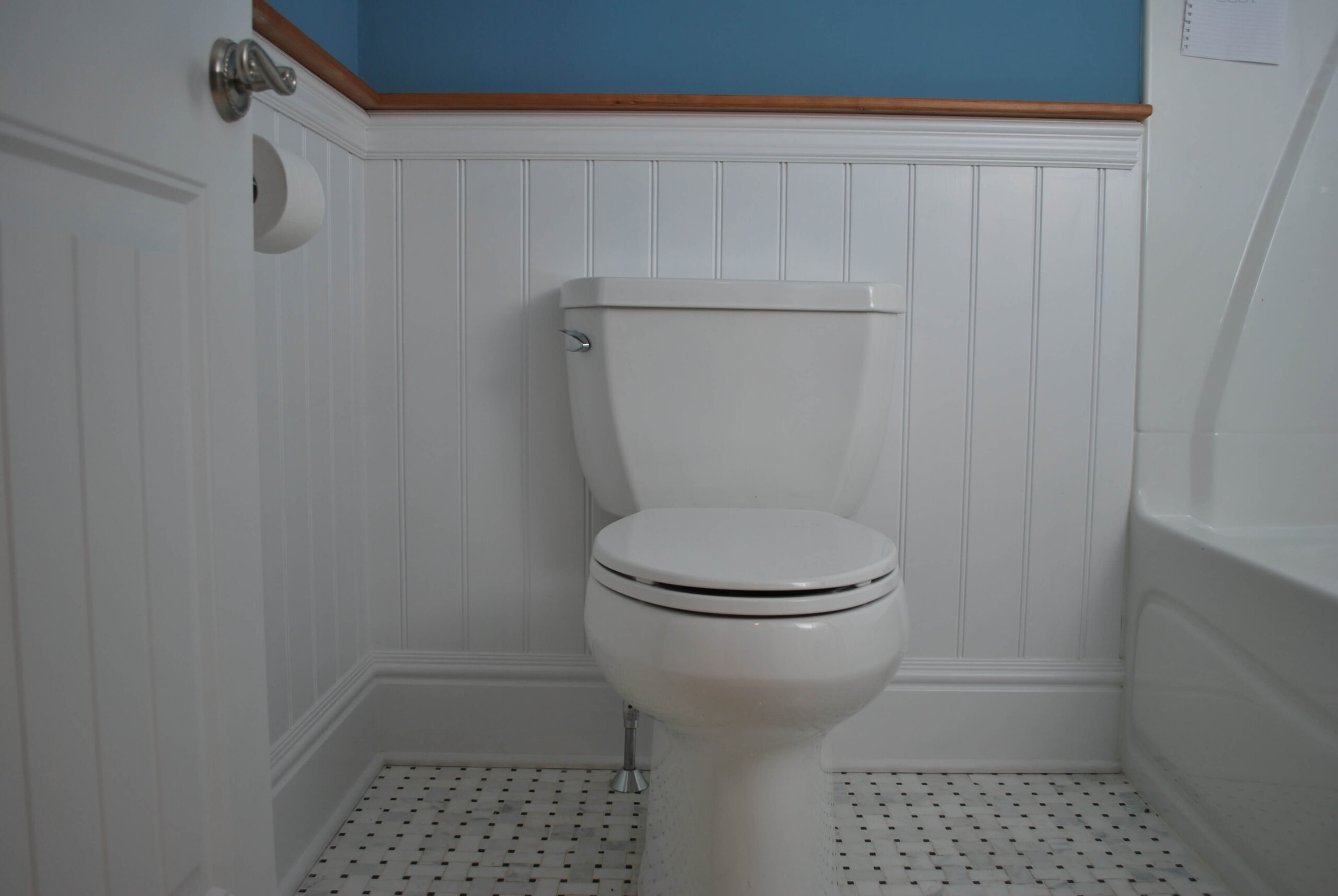 American Beadboard in a bathroom using hardwood top cap and chair rail in Westerly Rhode Island Beach House