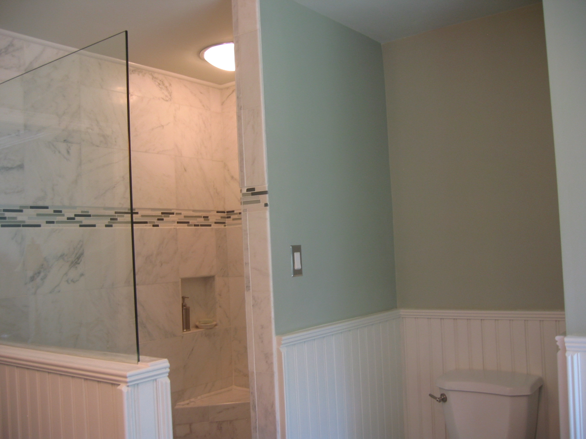 "American Beadboard in a bathroom with 1 5/8"" top cap chair rail molding and 4 1/2"" baseboard molding in a Bathroom Downingtown PA"