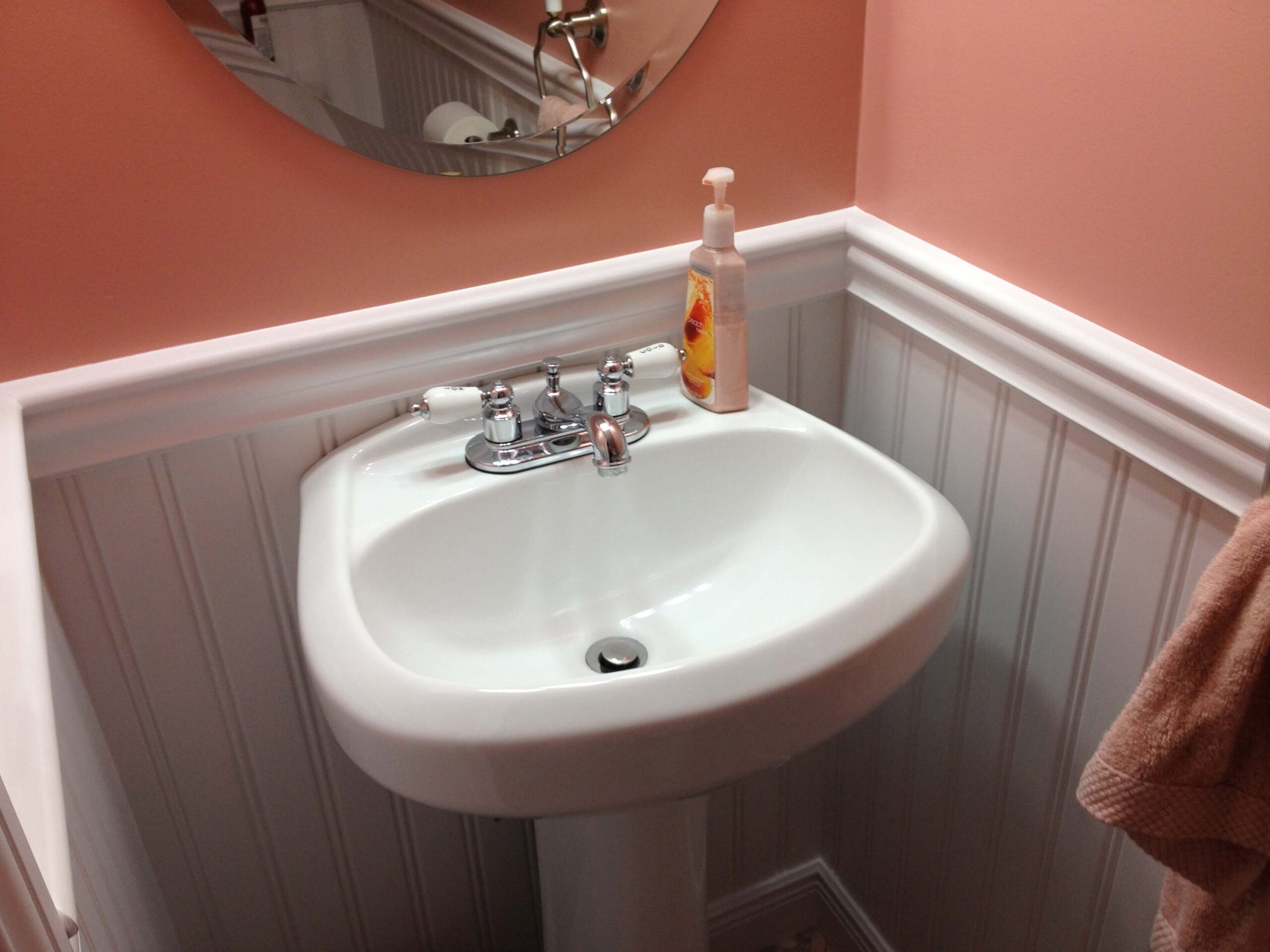 "Moisture Resistant American Beadboard panels with 2 1/2"" top cap chair rail and 4 1/2"" baseboard molding in a powder room in Stamford CT"